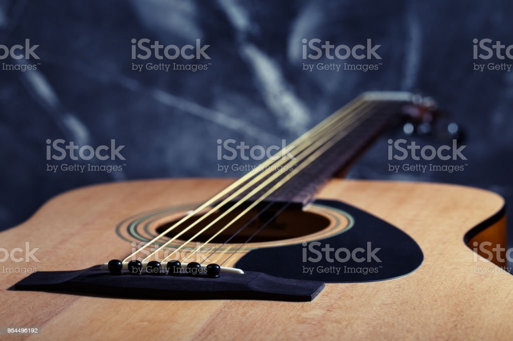 Six stringed acoustic guitar stock photo