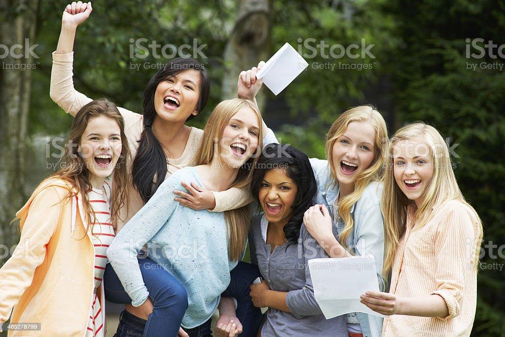 Six Teenage Girls Celebrating Successful Exam Results stock photo