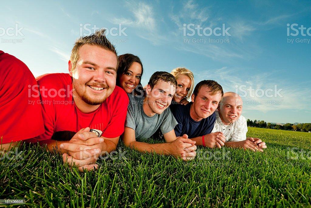 Six Teens Lying on the Grass royalty-free stock photo