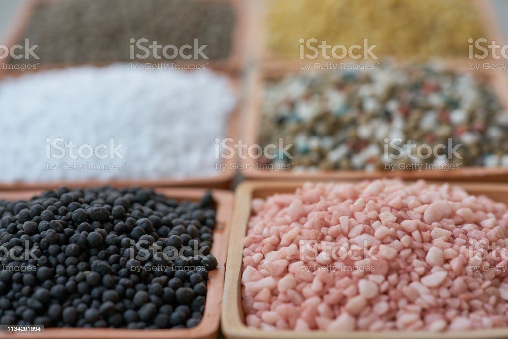 Six types of chemical fertilizers in clay pots stock photo