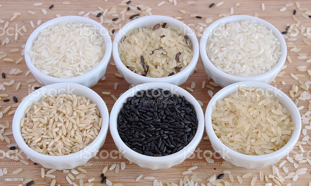 Six varieties of uncooked rice stock photo