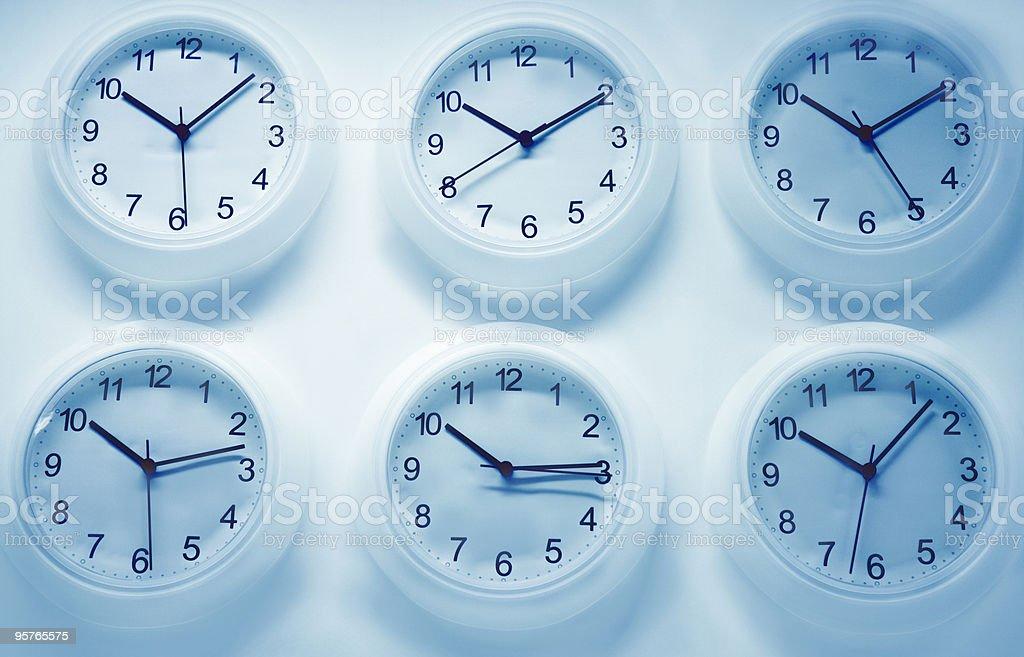 Six Wall clocks stock photo