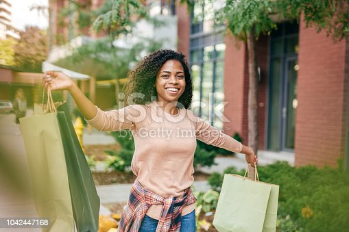 Young women with shopping bags outdoor