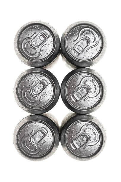 six wet aluminium drink cans stock photo