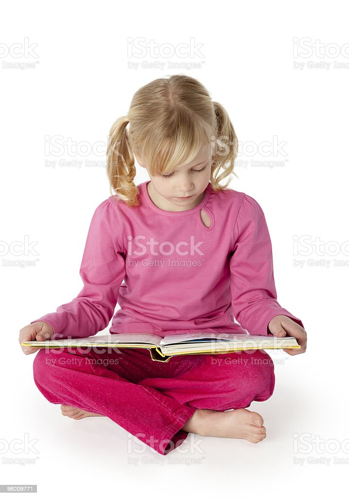 Six Year Old Girl Reading a Book stock photo