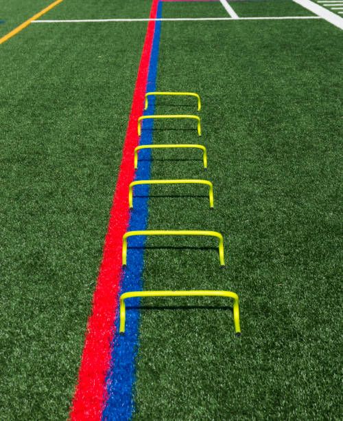 Six yellow mini hurdles lined up for speed practice stock photo