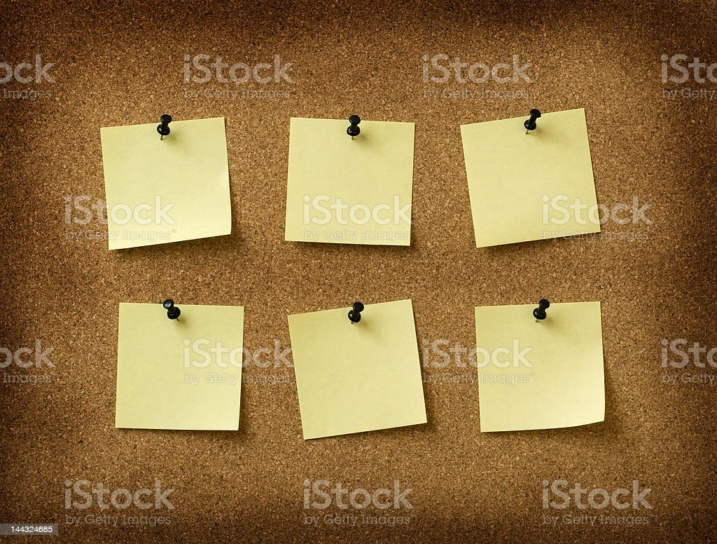six yellow notes pinned to grunge cork background royalty-free stock photo