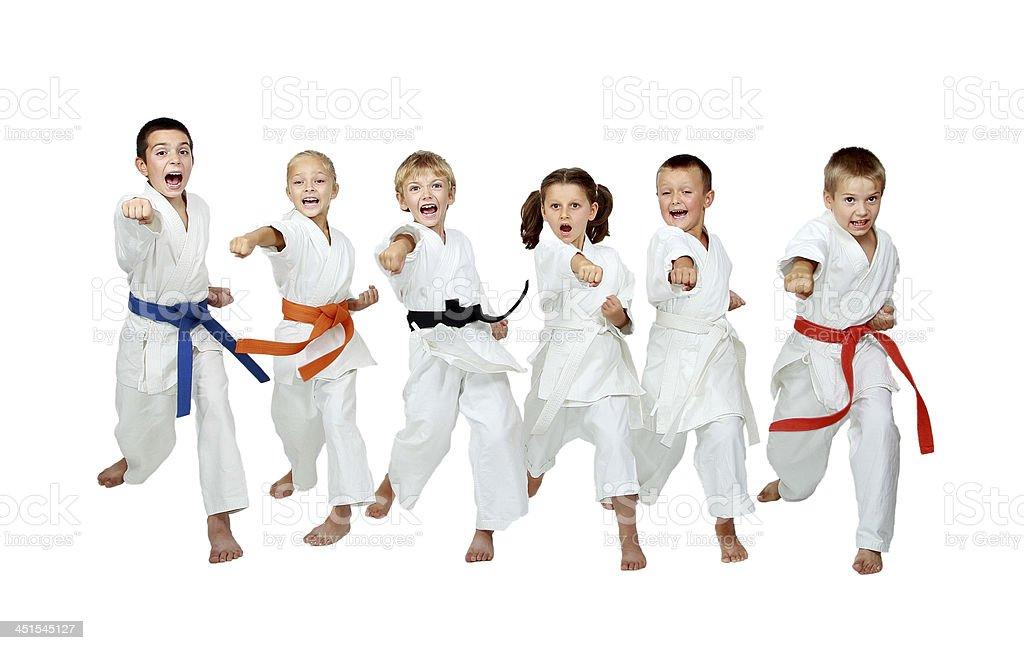 Six young athletes are hitting hand karate kick stock photo
