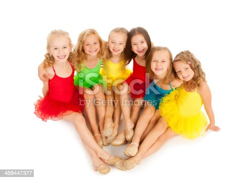 466300721 istock photo Six young girls wearing ballet outfits smiling 459447377