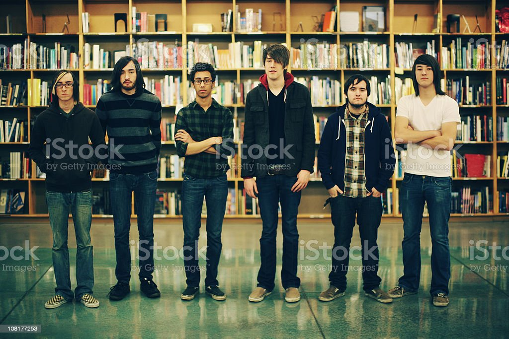 Six Young Males Standing in Library royalty-free stock photo