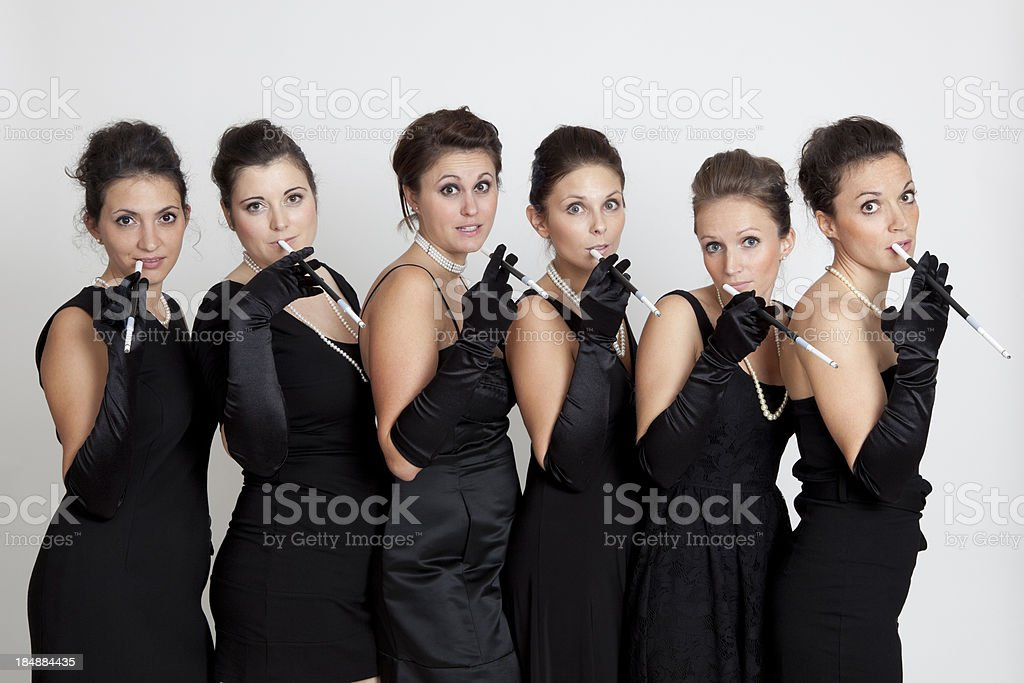 Six young women in black dress smoking stok fotoğrafı