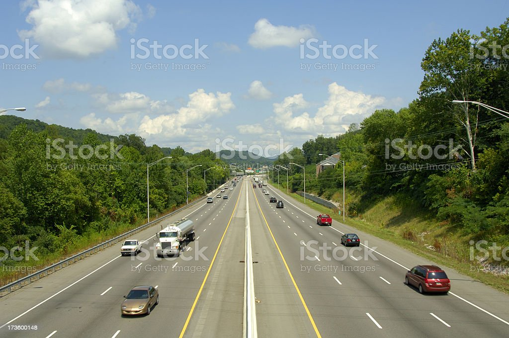Six-lane interstate highway with traffic royalty-free stock photo