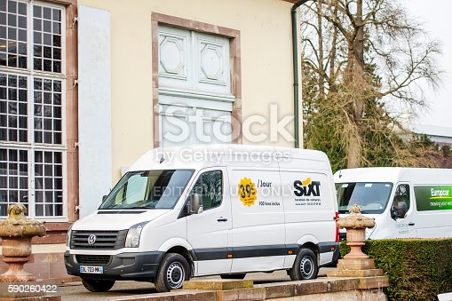1140988145 istock photo Sixt and Europcar renting vans in front of building 590260422
