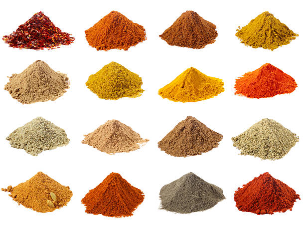 sixteen piles of Indian powder spices with its names stock photo
