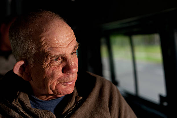 sixty-six year old man with a disability in bus - 60 69 years stock photos and pictures