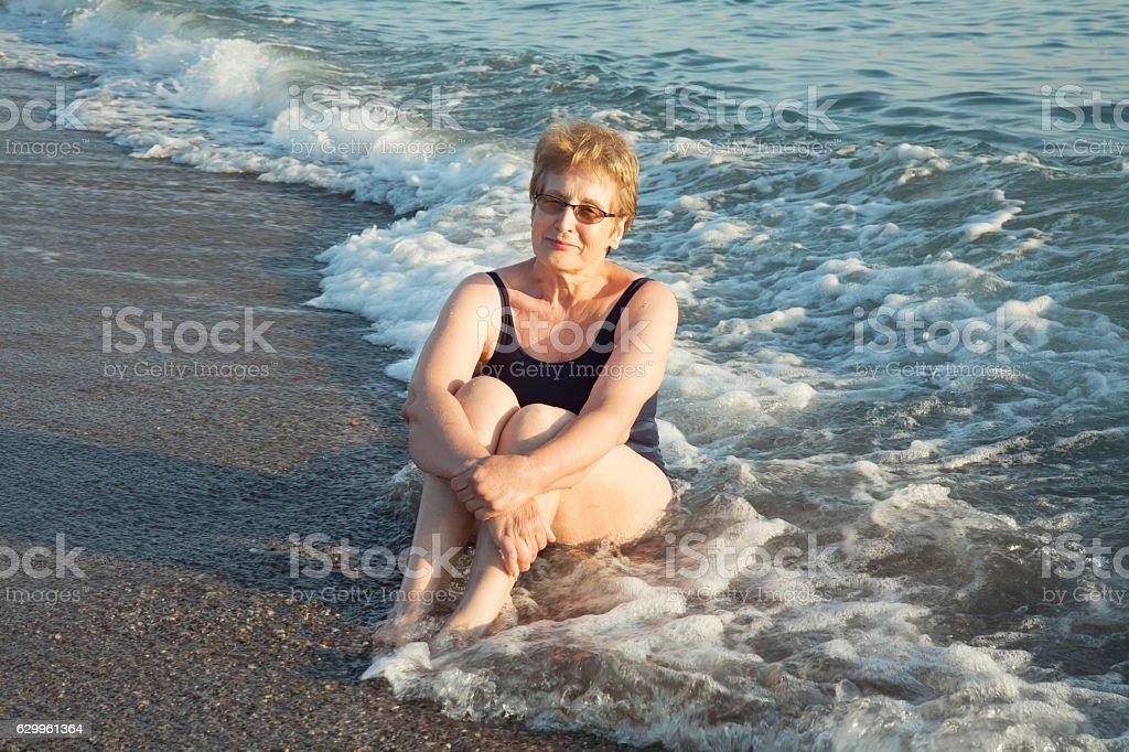 sixty-year beautiful woman bathing in the  sea waves – Foto
