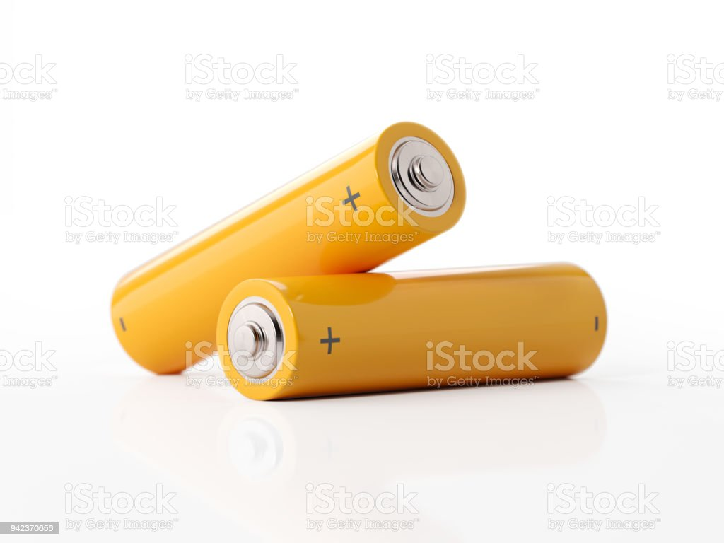 AA Size Two Yellow Batteries On White Background stock photo