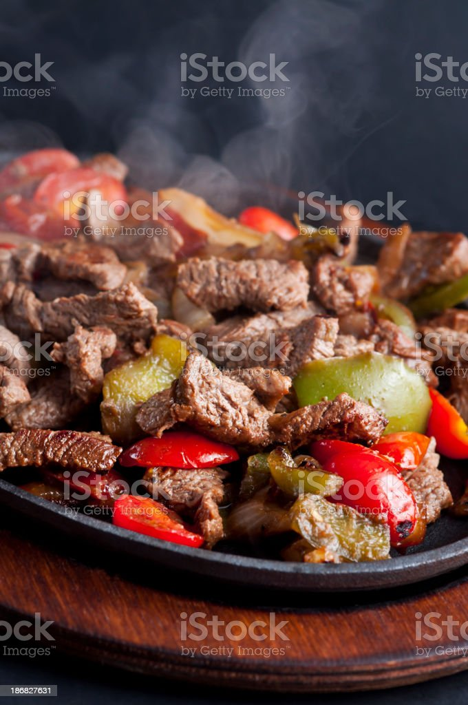 Sizzling beef fajitas straight from the stove royalty-free stock photo