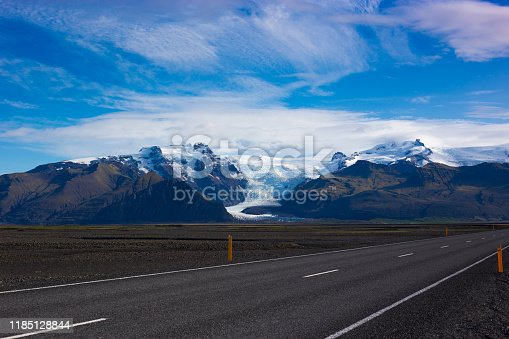 Skaftafell National Park, Iceland: The Ring Road (Highway 1) with snow-capped mountains and glacier in the background. Shot in September.