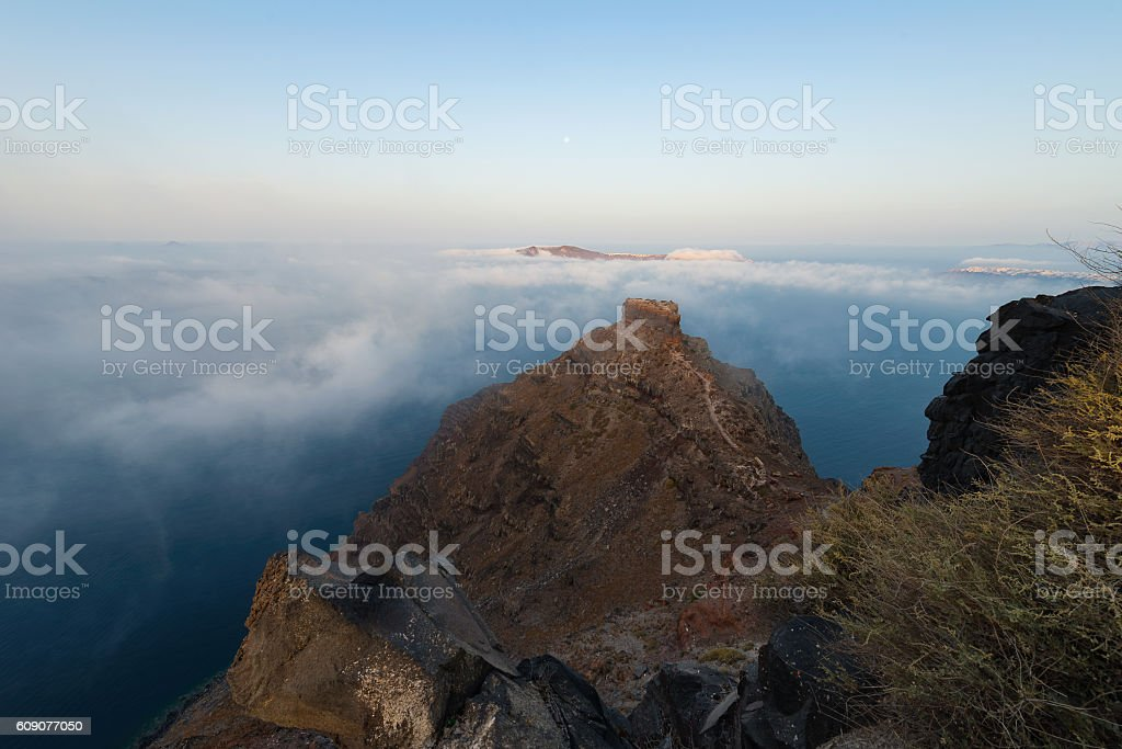 Skaros rock surrounded by clouds | Santorini stock photo