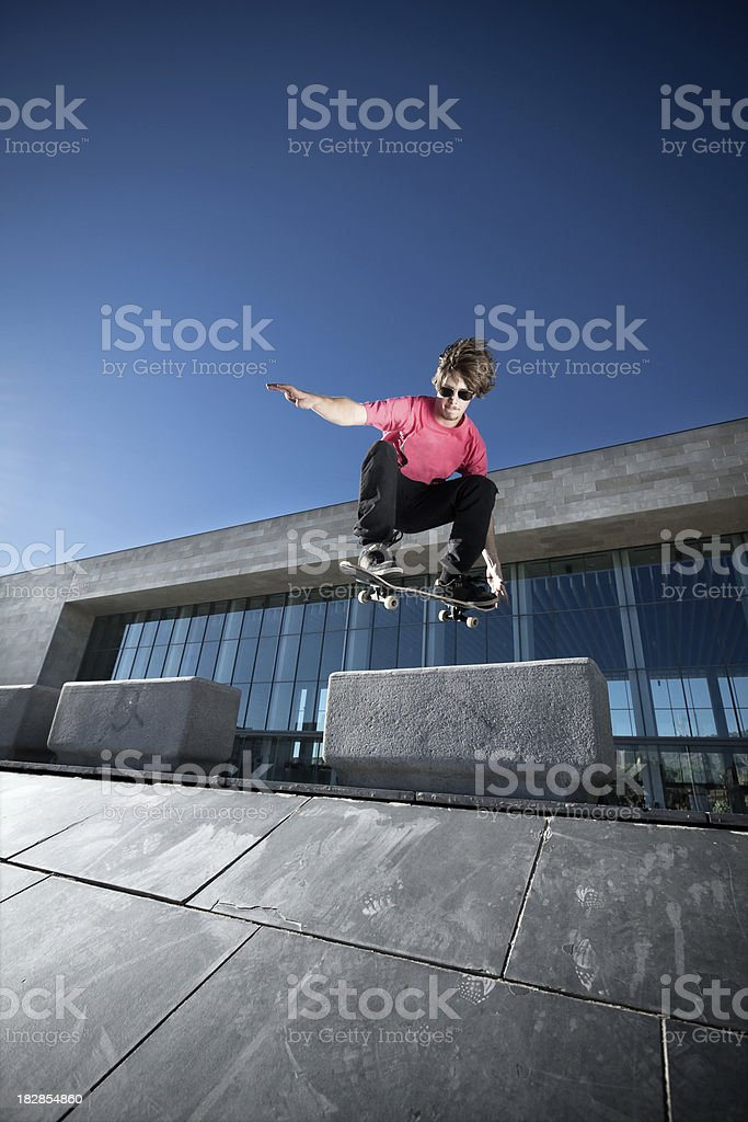 Skate boarder jumping royalty-free stock photo