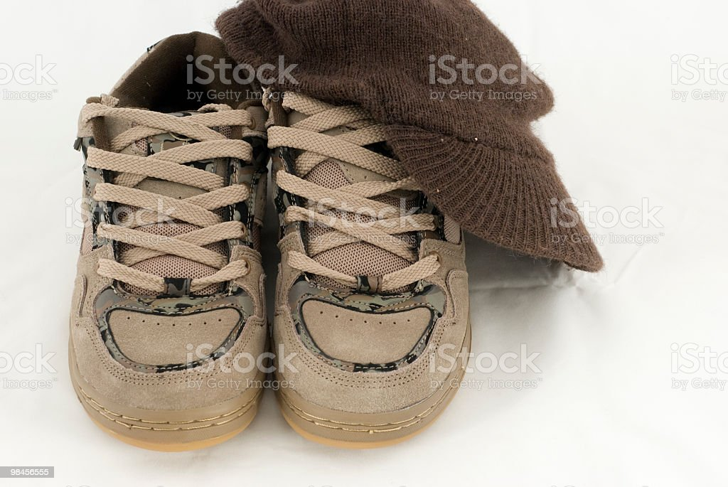 Skate shoes and hat royalty-free stock photo