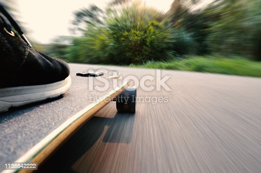 slide longboard on the asphalt; Low angle of view