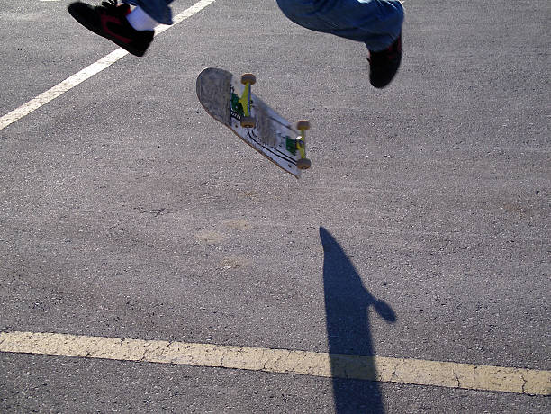 Skateboard trick with a shadow stock photo