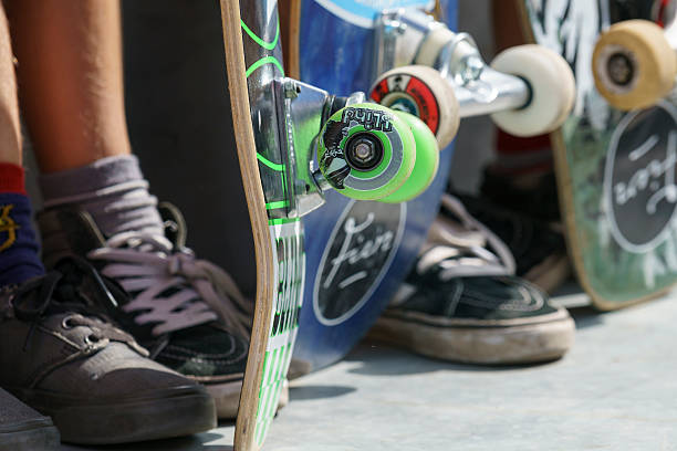 Skateboard wheels and feet stock photo