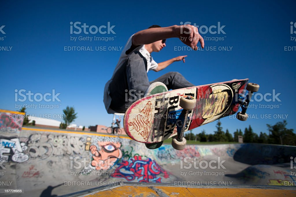 Skateboarder at a skate park stock photo