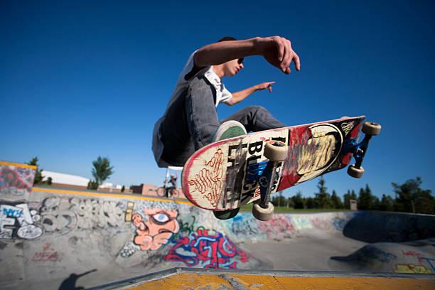 Skateboarder at a skate park stock photo