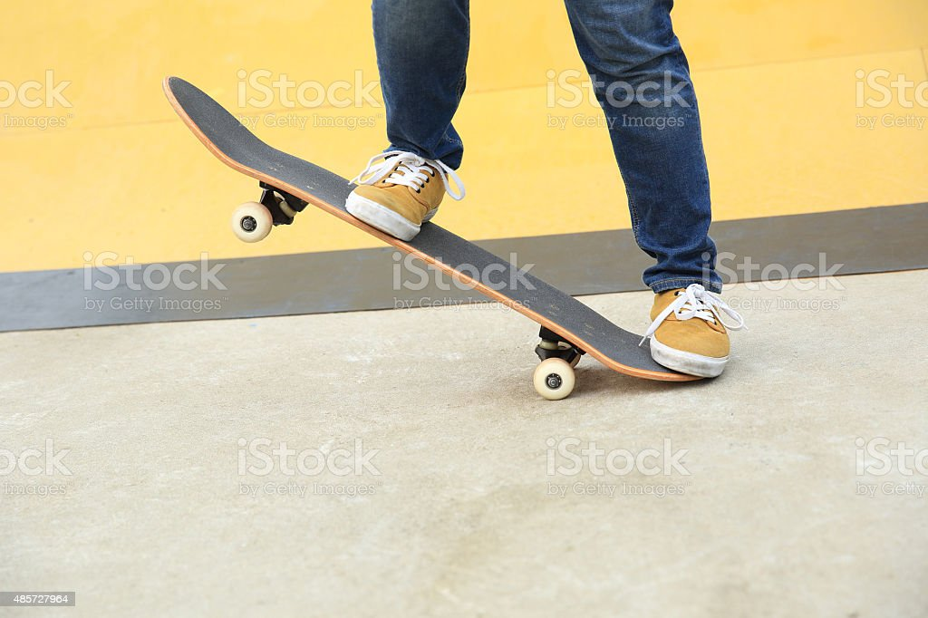 skateboarder at skatepark stock photo