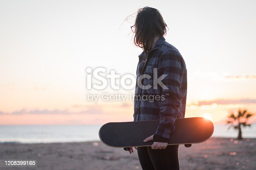 Skateboarder at the beach
