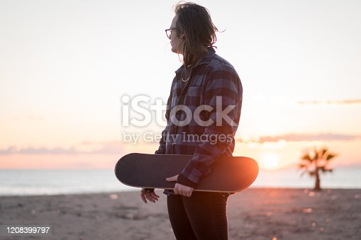 Skateboarder at the beach