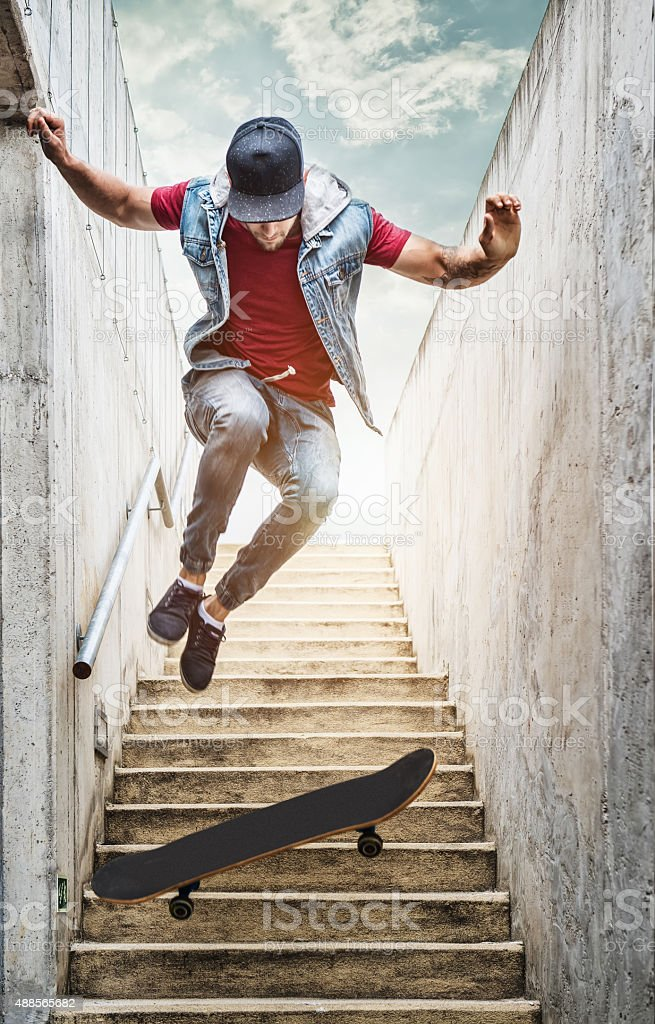 Skateboarder boy jumps off the stairs stock photo