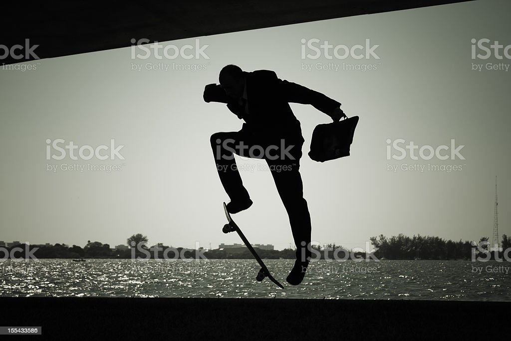 Skateboarder businessman in a suit royalty-free stock photo
