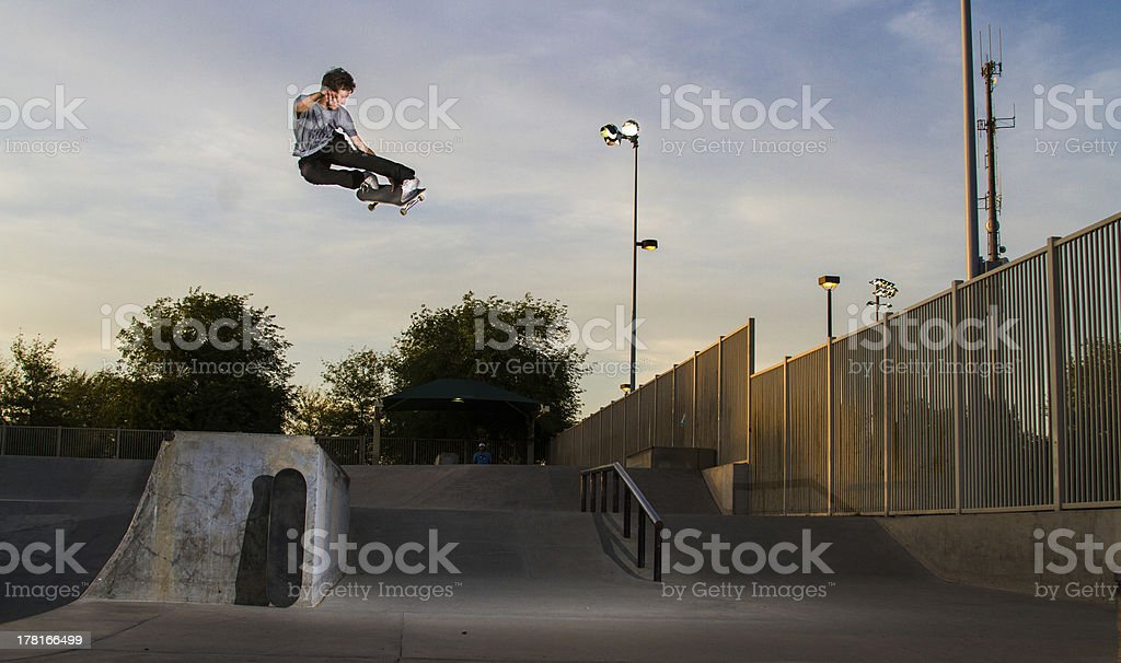 Skateboarder doing a trick in air stock photo