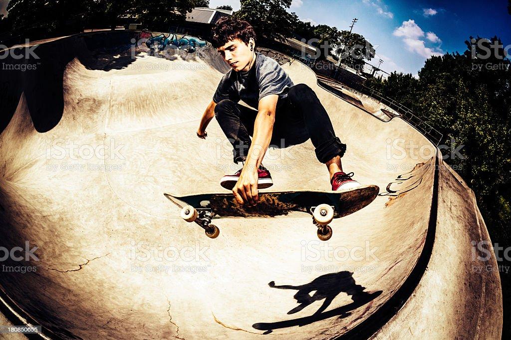 Skateboarder doing a trick stock photo