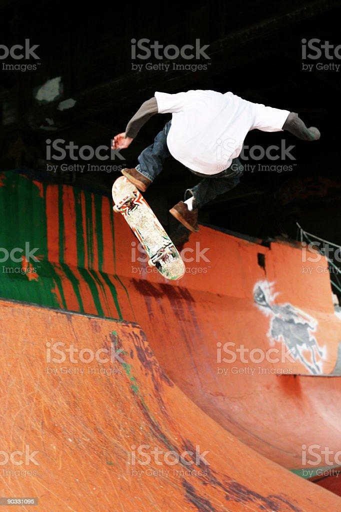 Skateboarder Doing Tricks on Half Pipe royalty-free stock photo