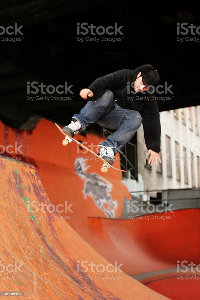 Skateboarder Dropping In on a Ramp royalty-free stock photo