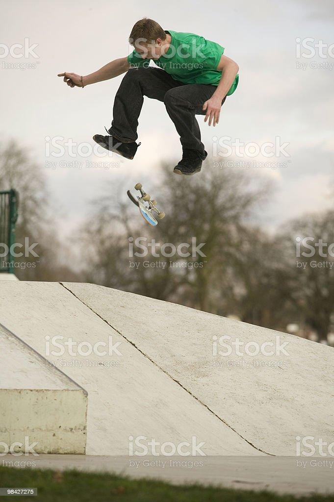 Skateboarder flips over a ramp royalty-free stock photo