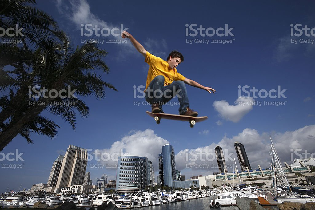 Skateboarder flying over San Diego royalty-free stock photo