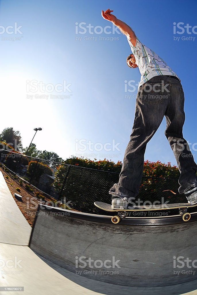 Skateboarder - Fronside 50-50 Grind royalty-free stock photo