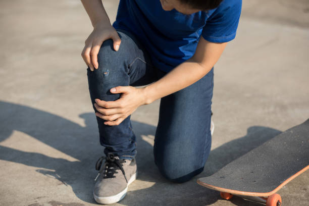 skateboarder got spirts injury skateboarding on skatepark stock photo