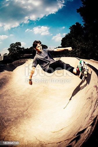 istock Skateboarder grinding in skatepark 180868233
