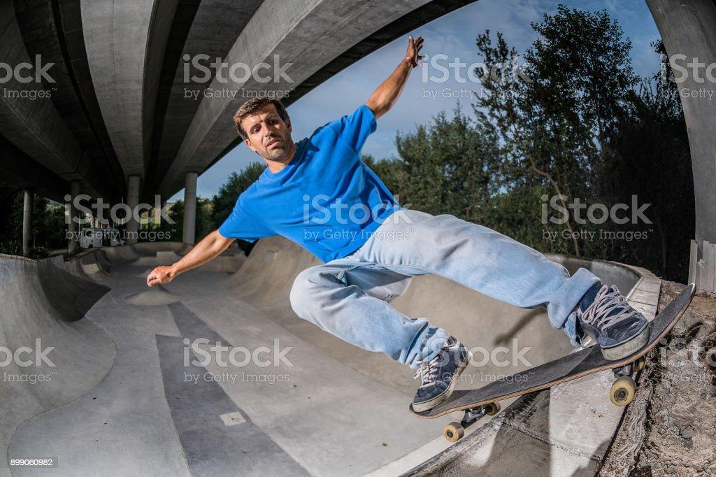 Skateboarder in a concrete skatepark stock photo