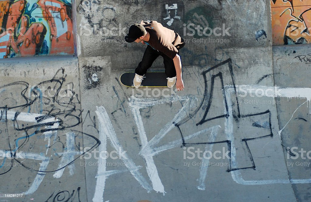 Skateboarder in half pipe stock photo