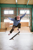 istock Skateboarder in Mid-Air Ollie 1207092633
