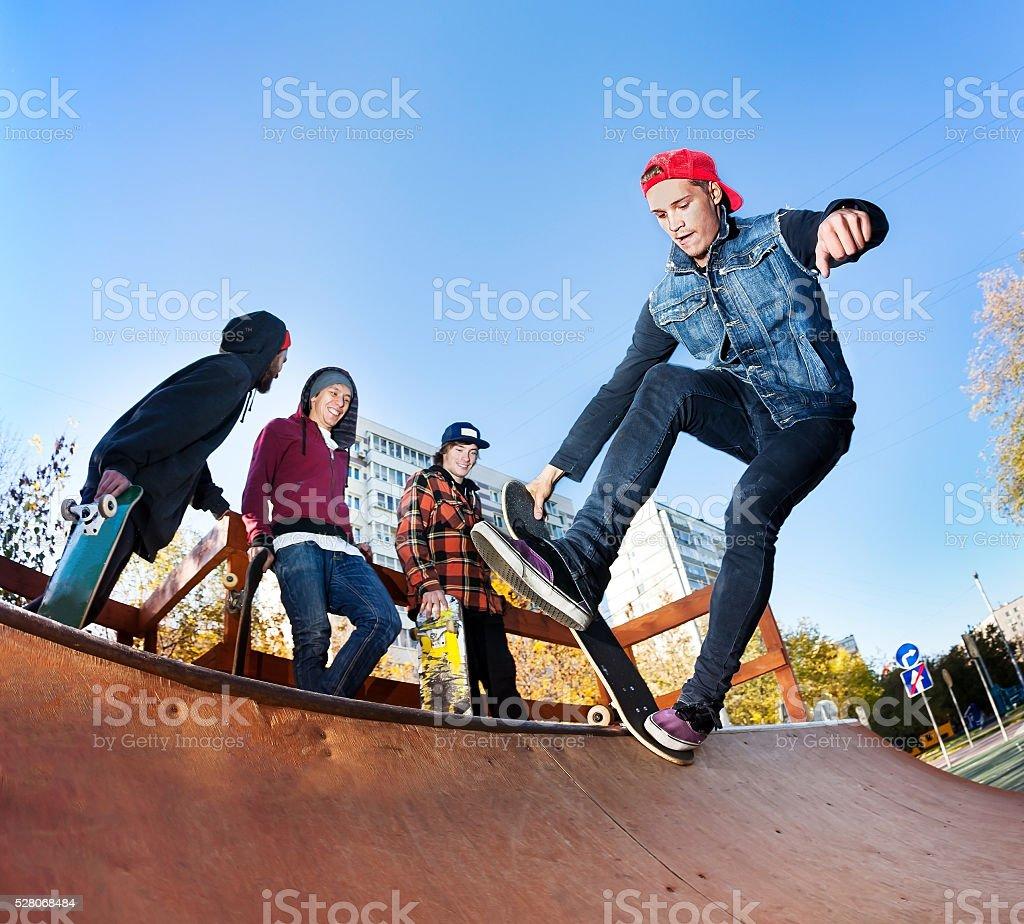 Skateboarder in skatepark stock photo