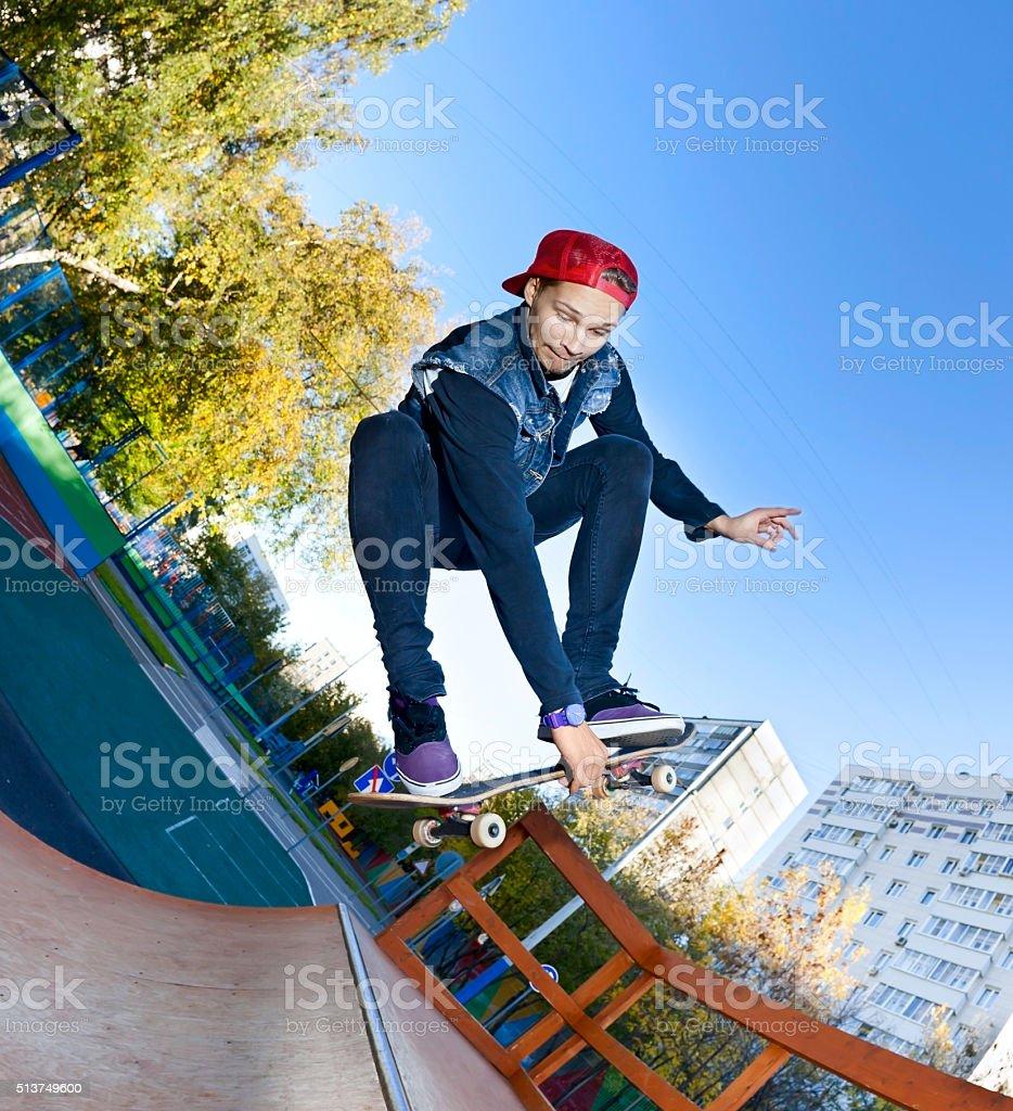 Skateboarder in the skatepark stock photo